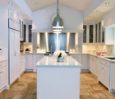 A Dark, Dated Kitchen Gets a Facelift in Florida Kitchen Cabinets Home Depot, White Kitchen Cabinets, Painting Kitchen Cabinets, Kitchen Remodeling, Remodeling Ideas, Kitchen Island, Freestanding Cooker, Classic White Kitchen, Glass Cabinet Doors