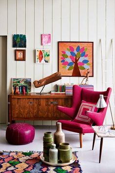 Urban homes. Love this pink upholster chair complimenting the colourful living room show pieces and rug.