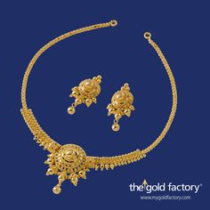 Charming little necklace set, distinguished by its design and workmanship. These lightweight 22K gold delights with their stamp of individuality is what makes The Gold Factory so special.  Necklace 12 gm and price 38,000/- Earring 5 gm and price Rs.15.900/-