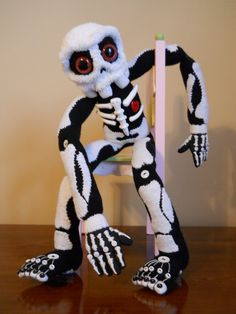 sock, skeleton, doll, embroidered, black and white, hand painted, eyes, safety eyes, horror, goth, day of the dead, sugar skull. $175.00, via Etsy.
