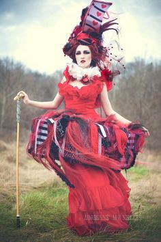 I love this picture the props in her hair really appeal to me and make the model resemble the queen if hearts even more i love the big hair and feathers, cards, crowns sticking out of it  to create a scary but strange appearance.