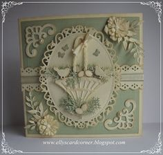 handmade Easter cared from Ellys Card- Corner: Voorjaar.... antique Victorian look  ... two colors: cream and pale green ... everything die cut ... central lacy framed oval with Easter basket with little birds, eggs, butterflies and grass. ... gorgeous card ...