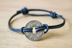 Simple sliding knot bracelet with antique African coin from KanduBeads. Photo and written tutorial in English. Could also do this with a Chinese lucky coin that also has a hole in the middle.