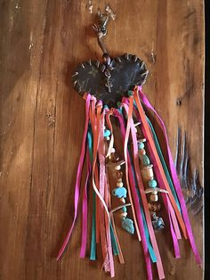 Boho-inspired vintage Monogram Canvas Louis Vuitton Dreamcatcher charm. Custom design your own charm! HEART OR ROUND-SHAPED AVAILABLE. Authentic LV Monogram Canvas upcycled and repurposed with leather tassels and beads. LISTING IS FOR 1 CHARM ONLY. Please state which shape you want