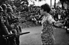 An American young girl, Jan Rose Kasmir, confronts the American National Guard outside the Pentagon during the 1967 anti-Vietnam march. Washington DC. 1967. Photo by Marc Riboud