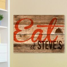 """This wood grain looking canvas print brings some charm to your home. It displays a sharp wood texture background with a brown dinner bell icon personalized for you. A great addition to country and western d'cor, it will also make a nice gift. Size: 18"""" x 24"""" x 1/2"""" #frame #canvas #eat #last #name #cute #family #kitchen #scroll #wood #personalized #present #gift #mom #birthday #Christmas #holidays"""