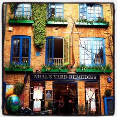 Neal's Yard Remedies in Neal's Yard, a small alley that opens to a courtyard with shops & cafes in Covent Garden. It's  between Shorts Gardens and Monmouth Street. A little oasis in London. Photograph by Andrea Rees | wanderingiphone.com