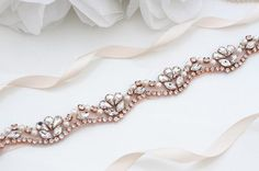 "bsolutely Dazzling Finest Crystal Rhinestone & Pearl belt will take your breath away!Made with clear crystals with rose gold. Great to sewn onto your dress directly . Measurement : 3/8"" width 17 - 48 length There is 3 yards long ribbon sash sewn underneath."