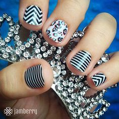 This isn't your typical black and white mani and we love it! Ring in the New Year with fabulously fun nails like these. Features: 'Black & White Skinny', 'Black & White Chevron', and 'Cheetah Illusion'. Jamberry Nail wraps. Black and white nails. Chevron Nails. Cheetah Nails.