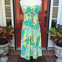 """Lilly Pulitzer Silk Halter Dress HPstefanilea Classic Lily with a twist; may be worn as a halter or strapless like this. Beautiful, colorful silk; it feels wonderful against your skin. Bust is 30"""" and length is 33"""" from the bust to the hem. All measurements done with  garment lying flat. White label Lily!  Host Pick 5/11/15 Romantic Style Party! Lilly Pulitzer Dresses"""