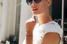"""Walk the line"" round-the-wrist bracelet-tattoo of model Nadja Bender"