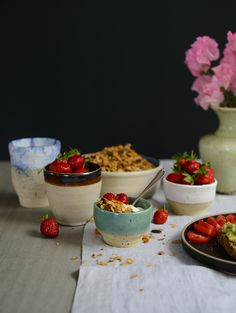 Let's breakfast! Granola, strawberries and yogurt pots.