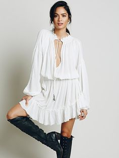 Love Me Like What Dress | Made from our sheer and gauzy Endless Summer fabric, this boho mini dress features a split V-neckline with beaded tie closures and an elastic waist. Easy ruffled hem with beachy raw trim. Throw on top of a bikini or layer over one of our seamless styles for an effortless look.  *Endless Summer  *Gauzy, sheer silhouettes for effortless layering under the sun. Whether you live the beach lifestyle year-round or dream of making the great escape, explore the Endless…