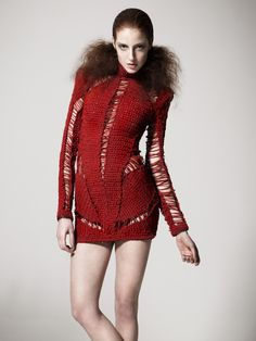 Here's a thought-provoking use of crochet for a dress design!