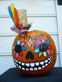 Celebrate Dia de los Muertos and Halloween all at once with a spooktastic sugar skull no-carve pumpkin.