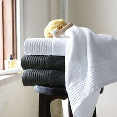 West Elm. Fluffy white towels are always a winner when preparing your house to sell