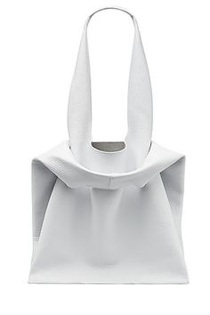 Jil Sander's modern white tote is made from textured leather, adding a weighty luxury to the understated color and minimal styling. We love the relaxed, shopper-inspired straps as a cool, directional finish #Stylebop