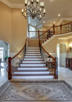 """Don't you want """"WOW"""" to be the first thing your guests say when they walk into your home? This beautifully designed staircase and eye-catching candle light fixture will make your home what everyone is talking about #GroveLiving"""
