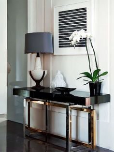 See more @ http://roomdecorideas.eu/beautiful-black-consoles-living-room/