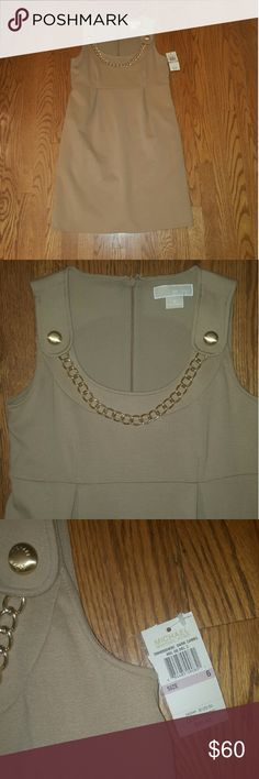 NEW tan Michael Kors dress size 6 Beautiful NEW with tags MICHAEL Michael kors dress tan with gold accents. Size 6. Thicker rayon/polyester material, does have a lining. Falls right at the knee. *price FIRM unless bundling (save 20%!) Going to consignment soon. MICHAEL Michael Kors Dresses Midi