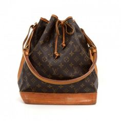 Authentic Louis Vuitton Noe shoulder bag. It has adjustable shoulder strap and tie up string closure. Inside is brown lining. The famous champagne bag created in 1932 which makes it a true classic.