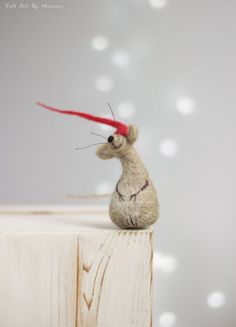This little needle felted Mouse was born in Sofia a few days ago. He has red hat and while waiting for Santa hes sitting on the fireplace. Size in centimeters: 8 cm high Size in inches: 3.1 high I use felt needle techniques and 100% pure wool form Bulgaria. I dye the wool by my self to achieve the right colors. I love to make little dolls and hope you like them too. https://www.facebook.com/FeltArtByMariana