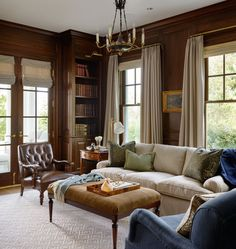 Wood paneled living/library. Massucco Warner Miller • Residential • Lake Washington Waterfront