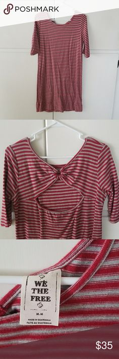 Free People We the Free dress Open back, scoop neck, red and grey striped knit dress. Bought NWT from another posher, took tags off to wash (it had a slight musty smell at the time), and never wore! So basically brand new. Length 35 inches. No flaws. Free People Dresses