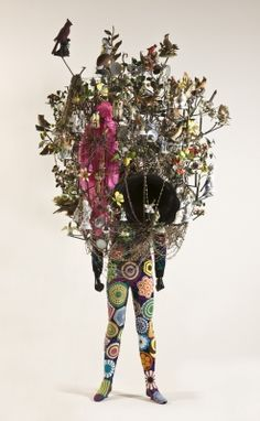 Soundsuit  Nick Cave  Soundsuit, 2011  ceramic birds and figures, metal flowers, gramophone, wig, beads, metal armature, appliquéd, knitted and crocheted fabric on mannequin  112 1/2 x 58 x 47 1/2 in.  Purchased with funds provided by the Acquisition Trust  2012.03