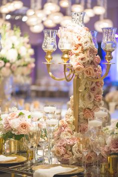 Pastel Garland on Gold Candelabra | Photography: Chip Gillespie. Read More: http://www.insideweddings.com/weddings/classic-jewish-wedding-at-a-synagogue-in-houston-texas/718/