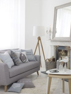 Nordic living room with penguin cushion | Sainsburys | The Relaxed Home