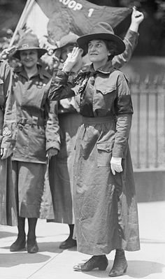 Juliette Gordon Low, founder of the Girl Scouts of the USA, salutes while wearing a Girl Scout uniform. 1917