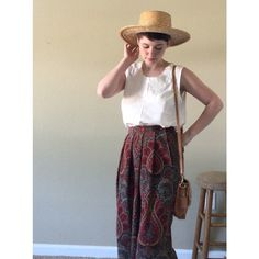 Vintage midi skirt Vintage midi skirt with beautiful paisley Moroccan design. Tag says size 10 but fits a modern medium/large. There is some stretch to the waist. NOT ANTHROPOLOGIE just using for visibility Anthropologie Skirts Midi
