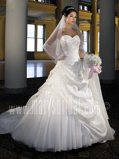 P.C. Mary's item 8629 -- likewise, the tulle under-layer can be changed, the appliques on it switched to a more colorful tulle.