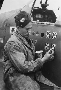 Sqn Ldr Eugeniusz 'Dziubek' Horbaczewski's kills being painted on his P-51 Mustang (FB387) at Brenzett, 3 August 1944. The Polish ace was the CO of No. 315 Squadron, and a record of his thirteen and a half aerial victories and four V-1s destroyed was painstakingly transferred to this newly delivered aircraft. He was shot down and killed on 18 August 1944.