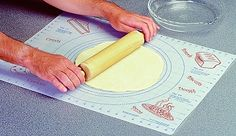 "PASTRY MAT The Pastry Mats is the perfect surface for rolling-out all kinds of pastry dough's, pie dough, tart dough, and cookie dough. Top surface is ""Non-Stick"", the Bottom surface is ""Non-Slip"" !  Also ideal for working and transferring rolled fondant, gum paste, pastillage, marzipan, confectionery work etc.  Guide markers set at 6"", 8"", 9"", 10"" and 16""  Overall mat dimensions: 24"" x 18""  $12.99"
