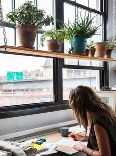 hanging shelf in window of studio
