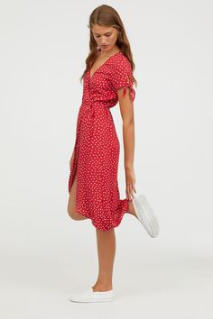 V-neck dress in woven, crêped viscose fabric. Short sleeves with knot-detail at cuffs, wrapover front with a tie at waist, and an asymmetric hem. SEE DETAILS One Piece Dress, The Dress, Dress Skirt, Dress Red, Red Skirt Outfits, Midi Dress Outfit, Red Polka Dot Dress, Khaki Dress, Modest Dresses