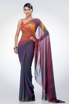A brown ikkat print saree, comes with a brown crepe-de-chine blouse piece.
