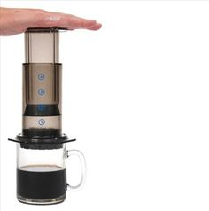 Aerobie AeroPress Coffee and Espresso Maker - 1 to 4 cup coffee and espresso maker. Takes about 1 minute from start to enjoying your cup of coffee or espresso. Comes with a funnel, scoop, stirrer and 350 micro filters. Coffee And Espresso Maker, Best Coffee Maker, Best Espresso, Espresso Machine, Coffee Cups, Coffee Snobs, Coffee Lovers, Double Espresso, Cappuccino Maker