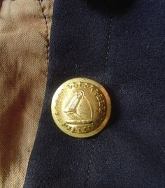 Close up of the button on the frock coat.