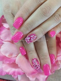 Pink gel polish with freehand nail art