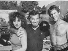 With Ryan O'Neal and their 'Main Event' director, Howard Zieff