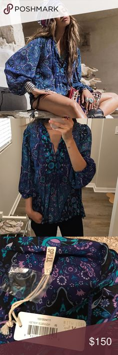 Brand new Spell and Gypsy Blouse Brand new with tags Spell and Gypsy Blouse. Size XS. Never worn! And sold out style! Price firm. I don't do trades. Also sold on Mercari Spell & The Gypsy Collective Tops Blouses