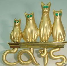 CUTE AREN'T THEY? ANOTHER GREAT CAT LOVER PIN.....THE WHOLE DANGED FAMILY IS POSING FOR THIS ONE.....THE CAT TAILS SPELL OUT THE WORD