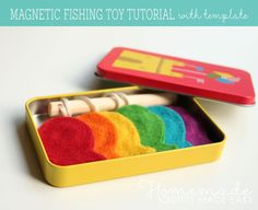 Homemade magnetic mini fishing game in a candy tin