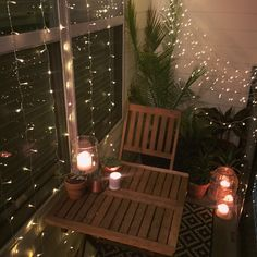 Small balcony decor ideas for an apartment. Hanging string lights window curtain string lights, succulents, desert plants, candles, lanterns, summer vibes. Home inspiration and outdoor space ideas Italian lights and palms tropical plants