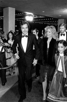 Neil Diamond arrives with his wife, #2, Marcia an0d daughter Elyn. Elyn and sister Marjorie are from his 1st marriage to childhood sweetheart Jayne Posner (1963-69). He and Marcia were married (1969-95) and had 2 sons, Jesse and Micah. He married for a 3rd time in 2012 to music mgr. Katie McNeil who is 42.