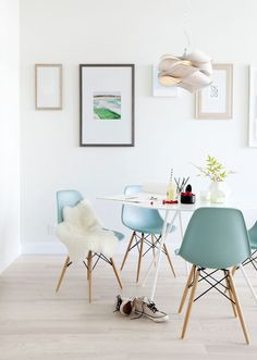Perfect dining room // blue eames chairs + architectural light fixture