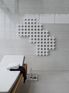 The add-On radiator by Indian designer Satyendra Pakhalé for Italian company Tubes is now on display at the Parisian Beaubourg.  Winner of a Red Dot Award, the sculptural radiator is made of pieces that are connected together to make just about any shape you desire. Doubling as wall art, this puzzle-like radiator is lightweight and can even be used as a partition.